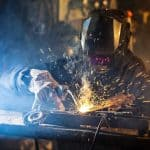 metal fabrication Welder in action with bright sparks