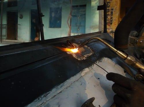 Man welding in protective gear