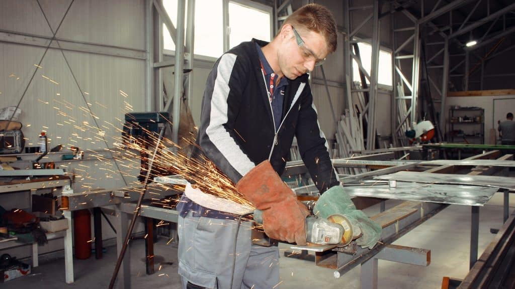 man using angle grinder